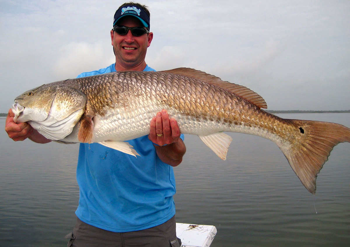 Orlando saltwater fishing photography cocoa beach for Red fish pictures